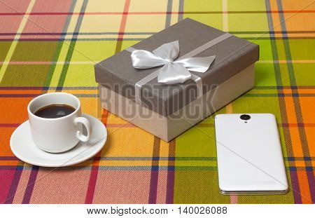 Coffee Cup gift in box smartphone on the table