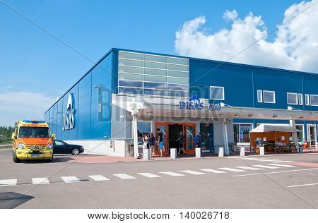 HAMINA, FINLAND - JUNE 26, 2016: People near the entrance to the Disas Fish Shop with seafood and caviar assortment