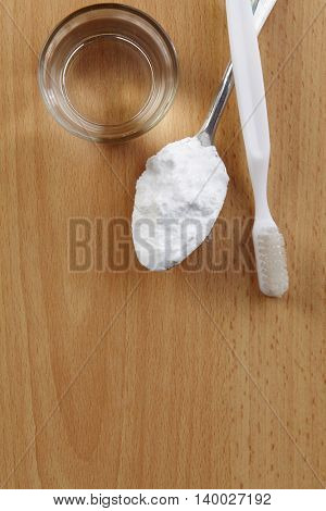 top view of baking soda with tooth brush