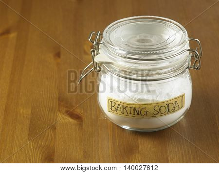 jar of baking  soda on the wooden background