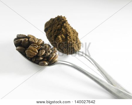 spoonful of the coffee powder and coffee beans
