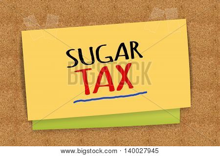 sugar tax word on yellow sticky note