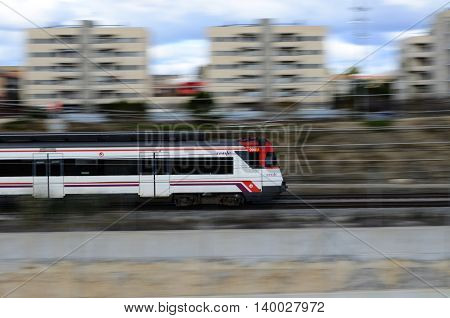 Vilafranca del Penedès, Spain - March 16, 2016: Panning shot of a RENFE train going to Barcelona (Catalonia, Spain)