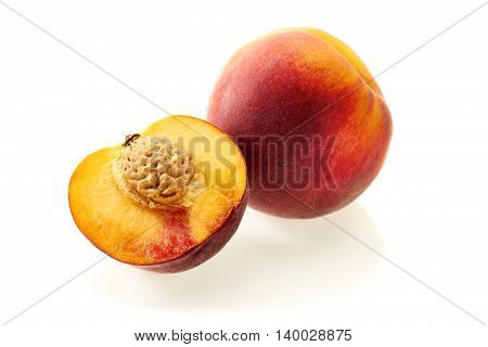 Peach and  half slice isolated on white background