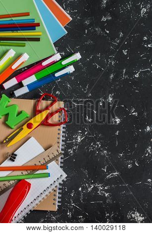 School accessories on a dark background. Top view free space for text