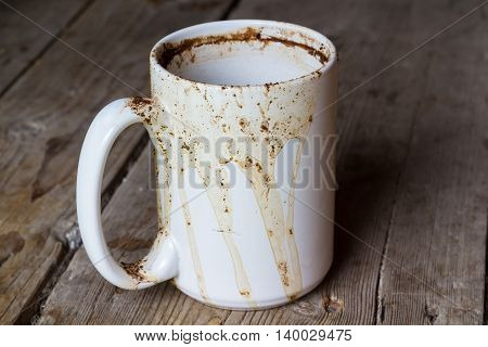Empty coffee cup on a wooden table
