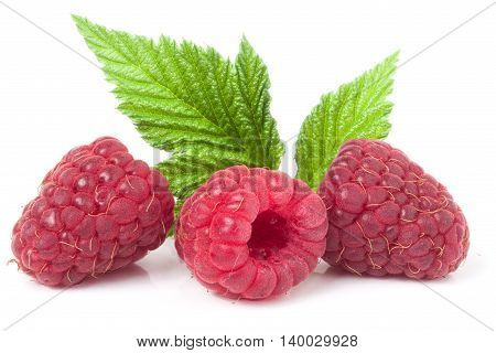 red raspberries with leaf isolated on white background macro.