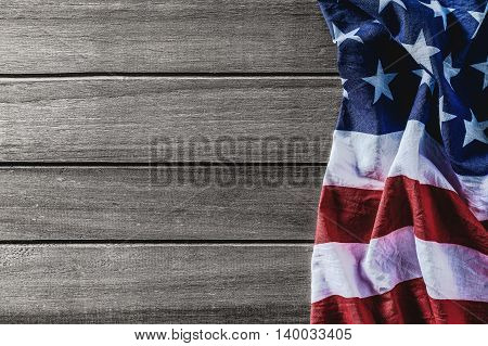 Overhead view of American flag on wood table American flag for Memorial Day or 4th of July United states of america flag