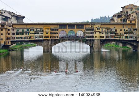 FLORENCE, ITALY - APRIL 27: Ponte Vecchio arch bridge over the Arno River on April 27, 2013 in Florence, Italy. It is the only bridge in Florence, has retained its original appearance since 1345 year.