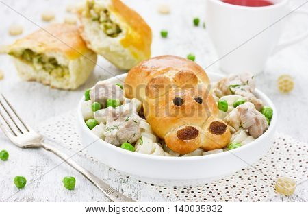 Patties with green peas for children in the form of a hippopotamus. Creative idea for baking on children's lunch selective focus