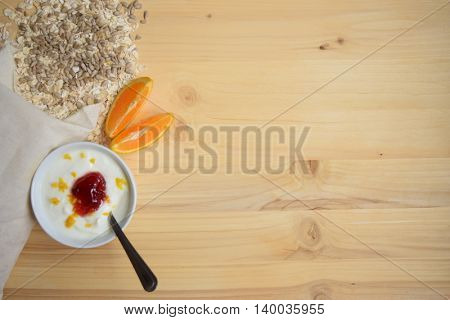 Healthy Breakfast. Yogurt with muesli  on wooden background. Health and diet concept. Top view.