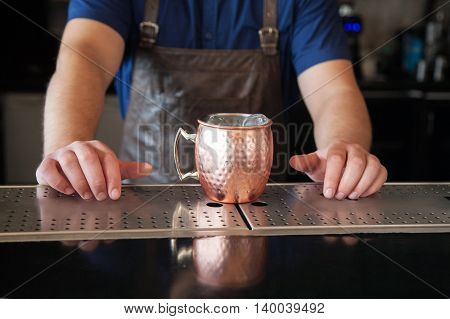 Bartender Hands On The Counter