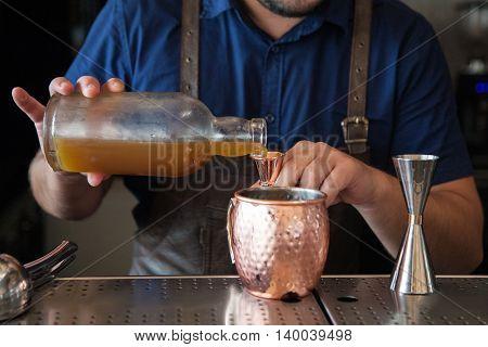Male Bartender Making Cocktails