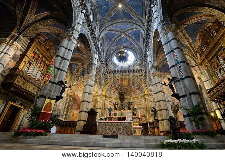 SIENA, ITALY - APRIL 28: Cathedral interiors of Siena, Italy, on April 28, 2013. Designed, completed between 1215 -1263 on the site of an earlier structure, a major tourism attraction in Siena
