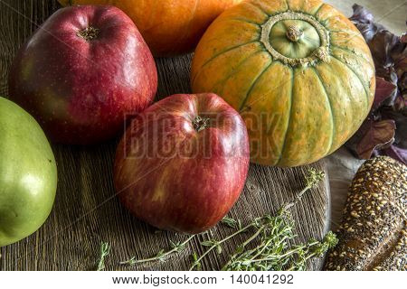 Red and green apples, squash, bread, thyme