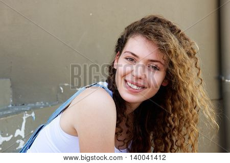 Smiling Teen Girl With Hair Blowing In Wind