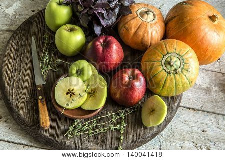 Red and green apples, squash, bread, thyme, basil