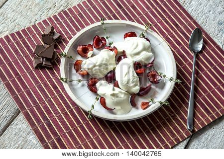 Cherry cream, chocolate, thyme on the table