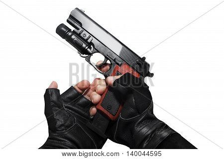 Hands in leather gloves reloading a gun clip first person view isolated photo.