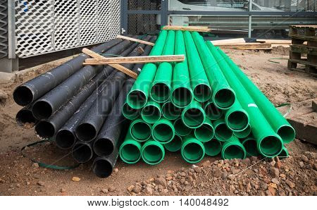 two colors of pvc pipes on a construction site