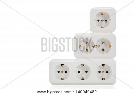 Several electrical outlets with grounding stand one another in three rows isolated on white background