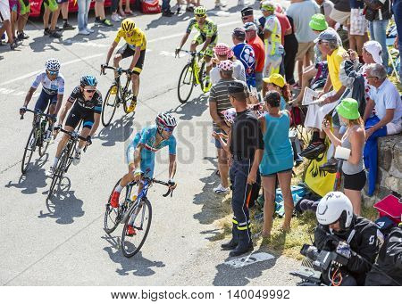 Col du Glandon France - July 23 2015: The Italian cyclist Vincenzo Nibali of Astana Team in front of a favorites group of cyclists riding in a beautiful curve at Col du Glandon in Alps during the stage 18 of Le Tour de France 2015.