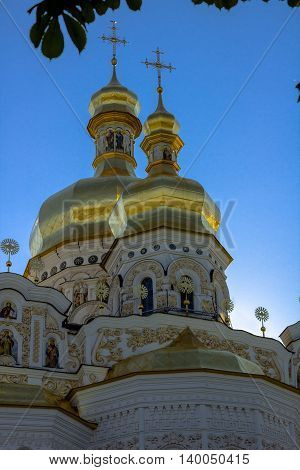 Golden tops and crosses of Christian Orthodox Abbey. Vertical photo