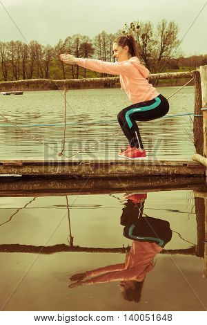 Girl Training In Sporty Clothes On Lake Shore