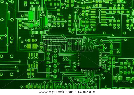 Close-up image of green board made for surface mount technology with one many-pins semiconductor component