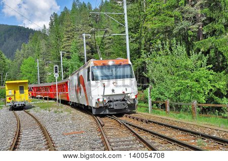 Wiesen Switzerland - June 08 2010: Passenger train from Davos approaches to the station platform.