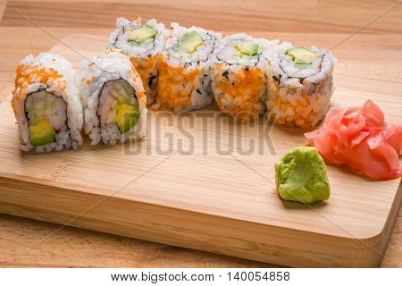 Sushi California rolls appetizer with rice avocado