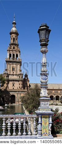 SEVILLE, SPAIN - September 13, 2015: Detail of the ceramic tiled balustrade and lamp pole at the Plaza de Espana (Spain Square) on September 13, 2015 in Seville, Spain