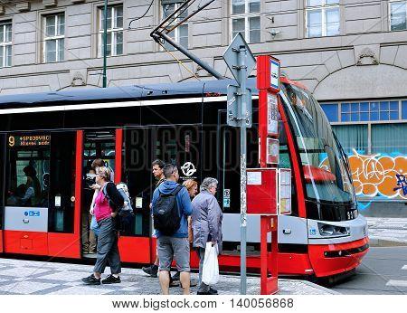 PRAGUE, CZECH REPUBLIC - JUNE 16, 2016: Red tram on street in Prague