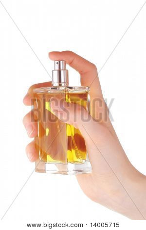 Yellow perfume in hand