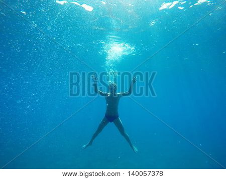 man dives into the sea