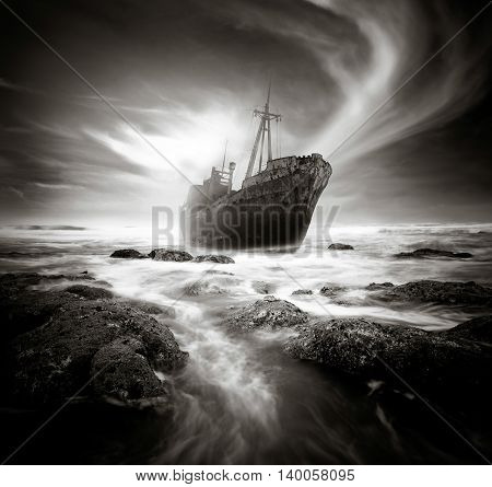 Shipwreck along a rough and rocky coastline.