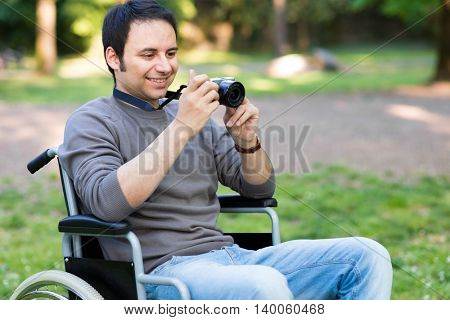 Smiling man using a mirrorless camera