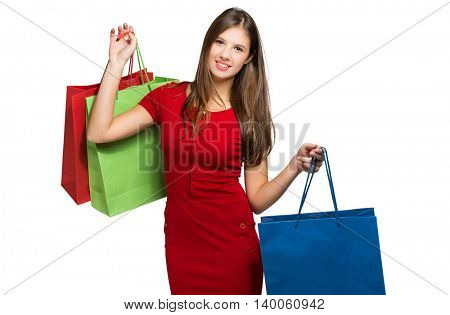 Woman in a red dress shopping isolated on white