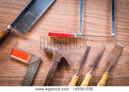 old & grunge set of hand tools many for carpentry on wood floor background
