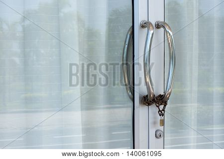 Door handles, stainless steel chain with a lock.