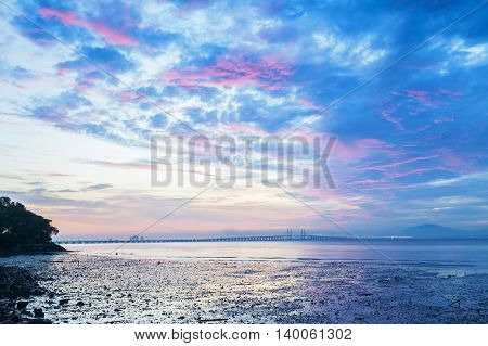 Purple Sunrise with boats and Penang Bridge view from Hammer Bay, George Town Penang, Malaysia