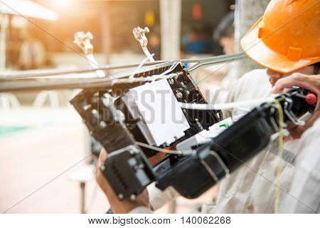 Technicians are install carbinet on fiber optic cable.Blur images with back lighting.