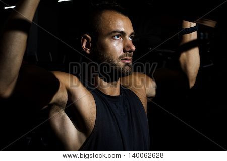 Handsome Man Training In Clean Modern Gym On Various Machines