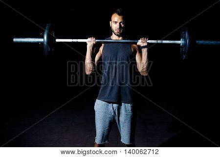 Fitness Man Preparing To Exercises With Barbell In Gym