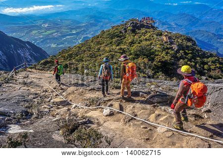 Ranau,Sabah,Borneo-March 13,2016:Group of climbers move down from Low's Peak to Laban Rata check point at Mountain Kinabalu on 13th Mac 2016.There are two summit trails,Ranau Trail & Kota Belud Trail.Climbing season officially opened on 1st December 2015