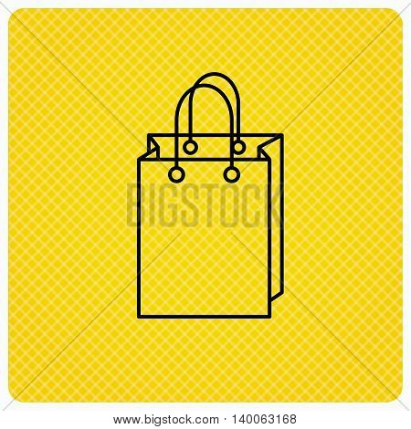 Shopping bag icon. Sale handbag sign. Linear icon on orange background. Vector