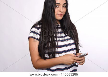 Young beautiful woman using her smartphone. Indoor. Isolated white background.