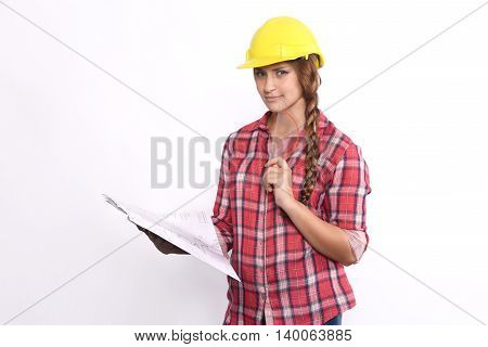 Portrait of beautiful woman construction worker reading blueprints and serious. Isolated white background.