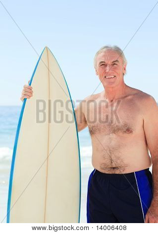Retired  Man With His Surfboard