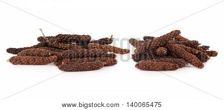 Closeup long pepper on white background. food